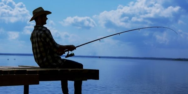 Image of a person fishing in afternoon