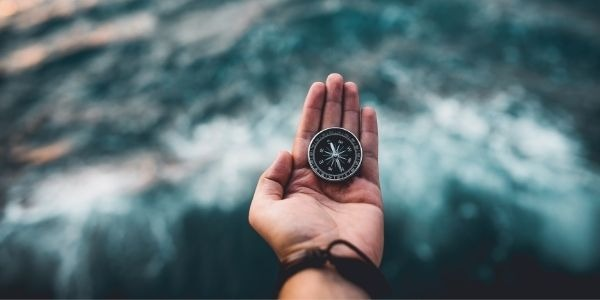 Image of a person holding compass