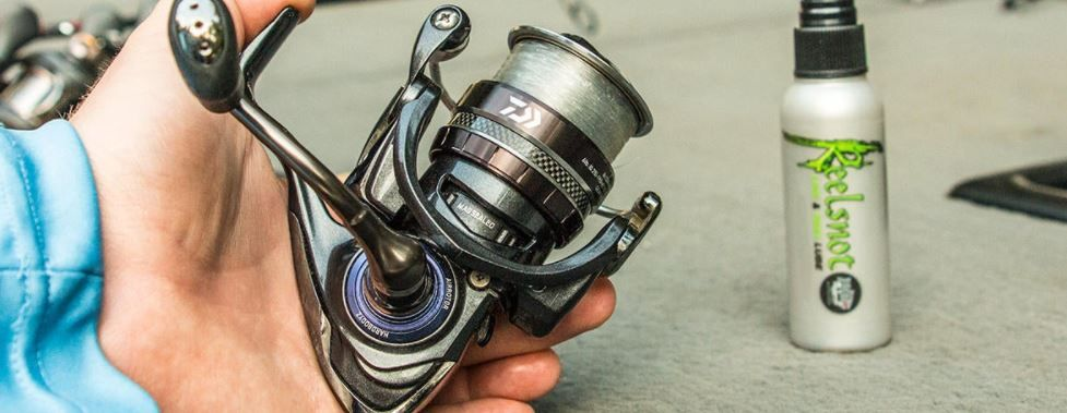Man Holding a Spinning Reel