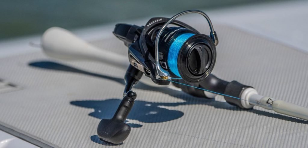 Spinning Reel lying on the boat