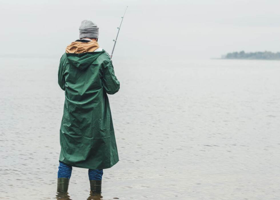 image of a person fishing in rain
