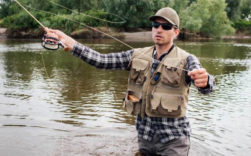 image of a person wearing fishing vest