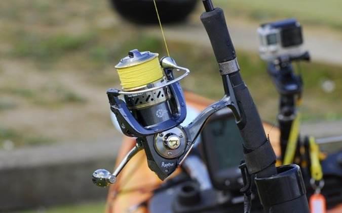 image of yellow fishing reel