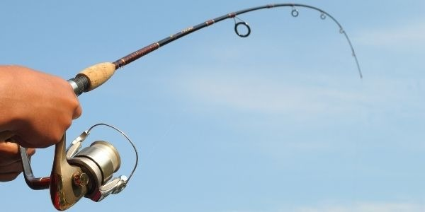Close up image of a person holding the fishing rod