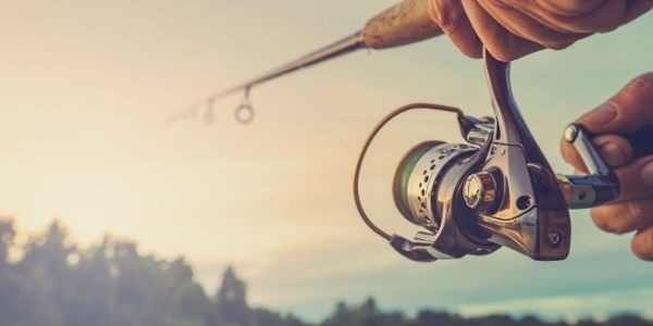 Image of a person holding fishing rod