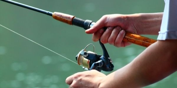 image of a person holding the fishing rod in two hands