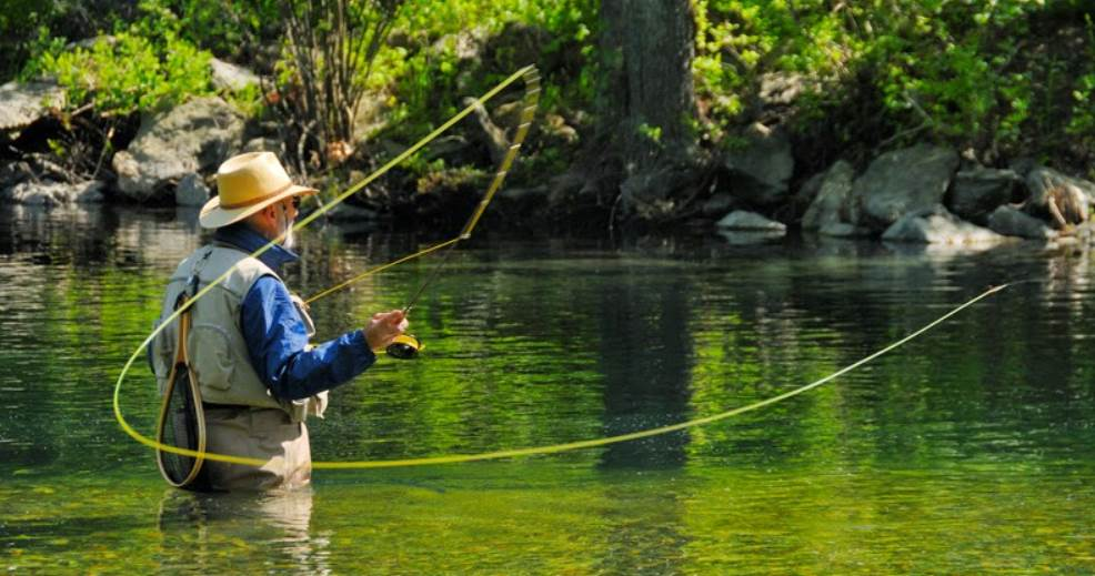 image of a person in lake doing fly fishing