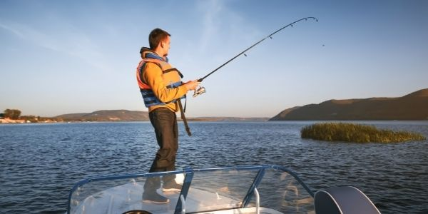 image of a person standing on a boat fishing