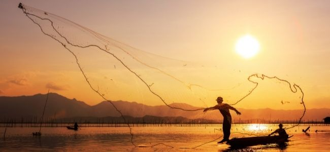 image of a person throwing fishing net