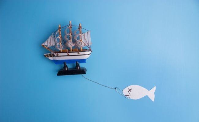 image of a toy boat catching a paper made fish
