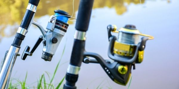 image of two fishing rods near a lake