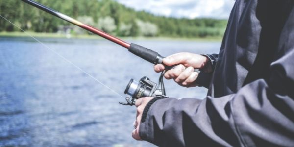 Side photo of a person fishing