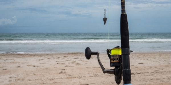 a close up image of the surf fishing rod
