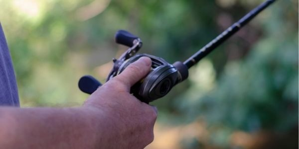 close up image of a person using a fishing pole