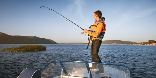 image of a person fishing on a boat