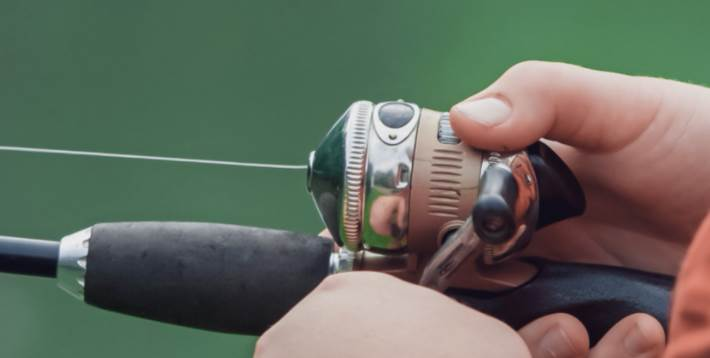 image of a person using the Spincast Reel