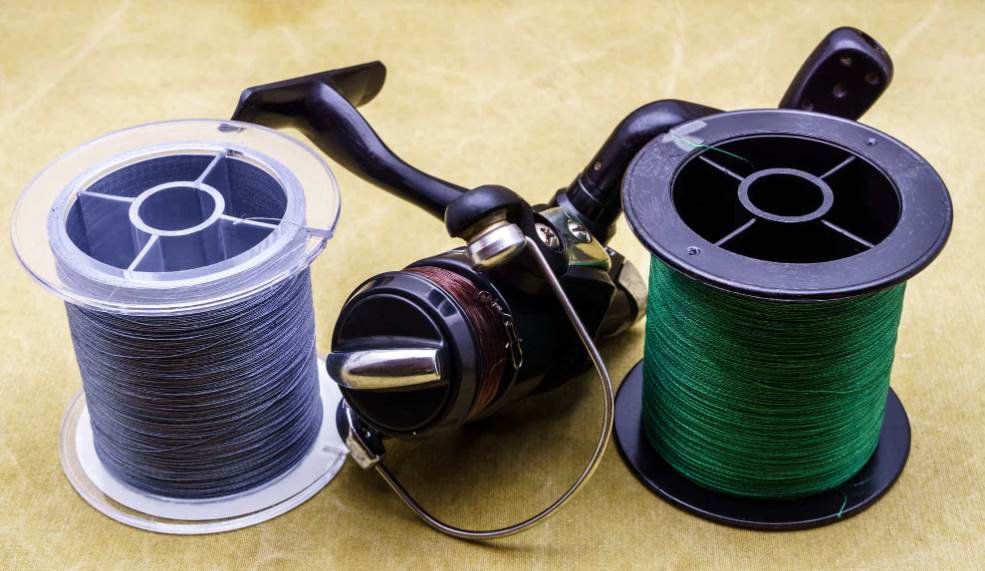image of two fishing lines with a reel